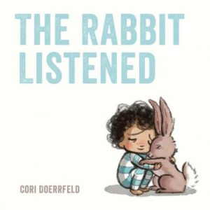 Illustrated child wearing blue and white stripes hugging brown rabbit. Children's book title in blue on white background: THE RABBIT LISTENED